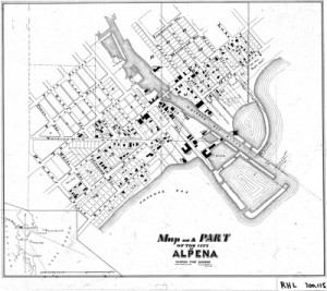 Figure 1.6 This illustration shows a large area plot plan of downtown Alpena and the piers where they were constructed. A detailed view is in Figure 1.7.