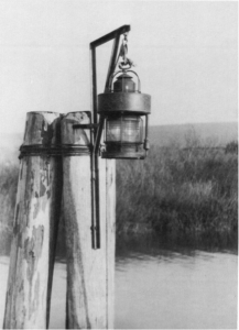 Figure 1.5 This illustration shows a similar style pile cluster light using a Lighthouse Service Post Lantern B lantern, which was used as the temporary light while the breakwater was being constructed.